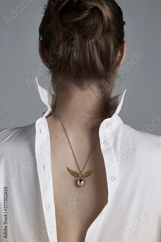 Cropped shot of a woman with symbolic necklace on her back Canvas Print
