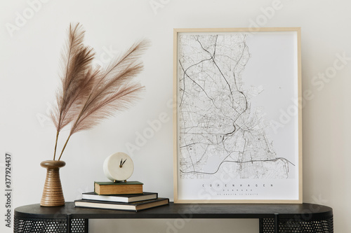 Fotografering Modern scandinavian home interior with design wooden commode, mock up poster map, feather in vase, book and personal accessories in stylish home decor