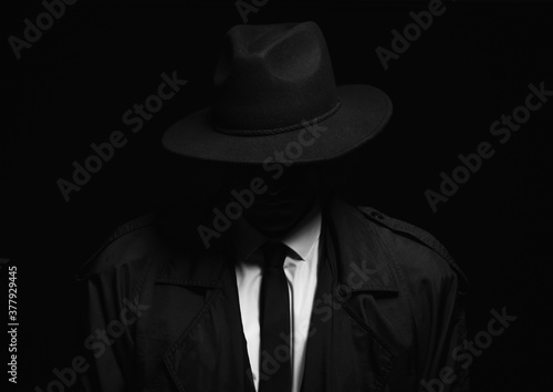 Old fashioned detective in hat on dark background Canvas Print