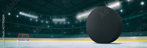 Slika na platnu Sport indoor ice hockey arena with black puck on the ice rink as widescreen background