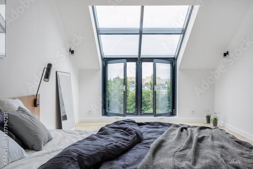 Attic bedroom with big window Fotobehang