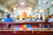 A Blurred Background Photo Of The Inside Of A Vietnamese Church Sanctuary That Is Filled With People In The Pews, And The Pastor Stands Under A Large Cross At The Altar, In Vietnam.