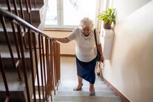 Senior Woman Climbing Staircas...