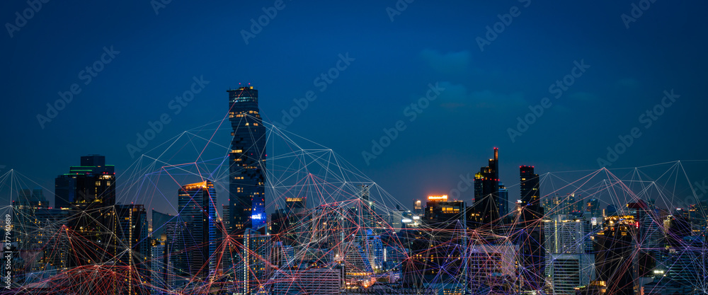 Fototapeta Modern city with wireless network connection and city scape concept.Wireless network and Connection technology concept with city background at night.