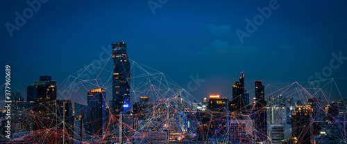 Fototapeta Modern city with wireless network connection and city scape concept.Wireless network and Connection technology concept with city background at night. obraz