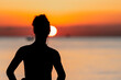 silhouette of a girl on a sunset background