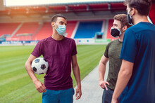 Soccer Players In Football Stadium During Covid-19 Wearing Masks
