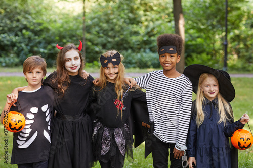 Tablou Canvas Portrait of multi-ethnic group of children wearing Halloween costumes while stan
