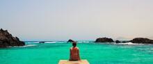 Woman Relaxing On The Beach In Isla De Lobos