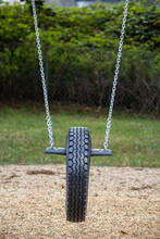 Vertical Shot Of A Tire Swing In A Playground