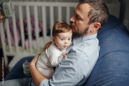 Middle age Caucasian father hugging newborn baby Fototapet
