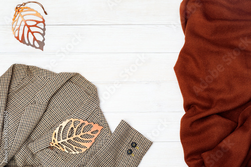 Fotografia Autumn flat lay with checkered jacket and warm scarf
