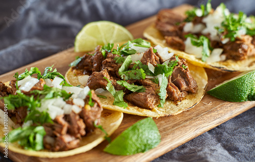 Canvas-taulu three carne asada mexican street tacos in corn tortilla with lime