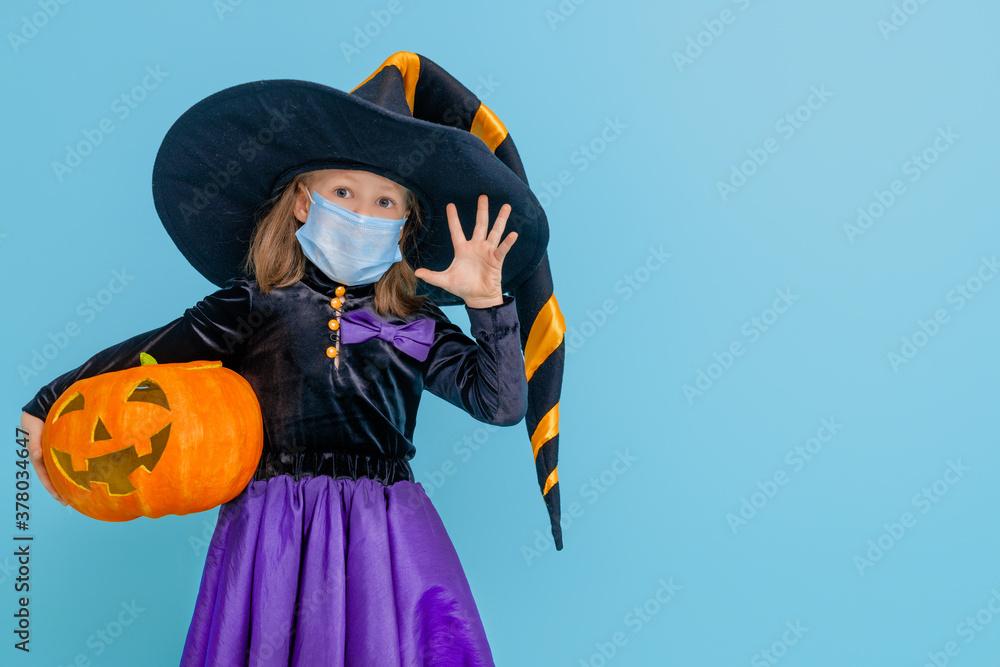 Leinwandbild Motiv - Konstantin Yuganov : witch with a pumpkin  wearing face mask