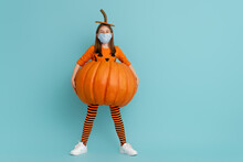 Girl In Pumpkin Costume  Weari...