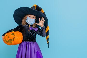 Fototapeta Golf witch with a pumpkin wearing face mask