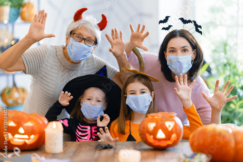 family celebrating Halloween - 378034617