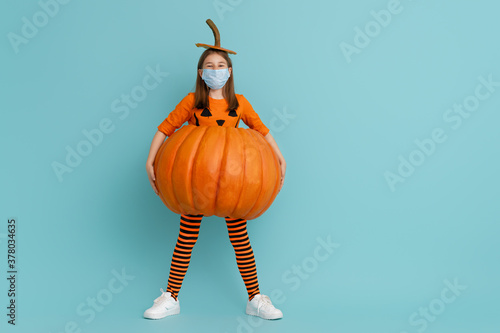 girl in pumpkin costume  wearing face mask Canvas