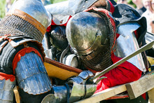 Medieval Restorers Fight With Swords In Armor At A Knightly Tournament
