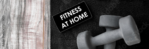 Fototapeta Fitness at home online streaming class for gym workout with free weights on mobile phone screen. Banner of dumbbells on exercise mat and smartphone for health progress tracking app. obraz