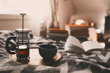 Cozy Winter Morning At Home With Hot Tea. Having Breakfast In Bed In Real Life Interior, Relaxing With Book