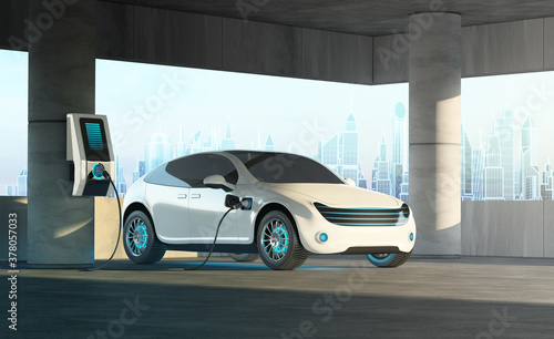 Fototapeta A futuristic electric car is connected to a charging station in an overhead multi-storey parking lot against the backdrop of a cityscape