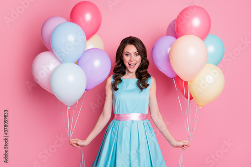 Photo of curly charming lady festive clothes event prom party hold both hands many air balloons celebrate birthday wear blue teal mini dress skirt isolated pastel pink color background
