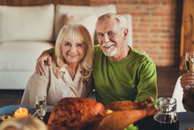 Portrait Of Thanks Giving Meeting Elderly Couple Embracing Sit Table Dinner Young Living Room Indoors