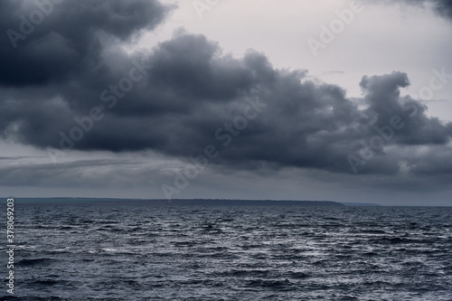 Fotomural dark stormy sea and dramatic clouds, gloomy nature