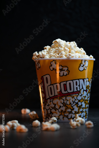A bucket full of popcorn black background Canvas