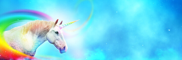 Ancient mythical unicorn with colorful rainbow. Panoramic style with wide copy space.