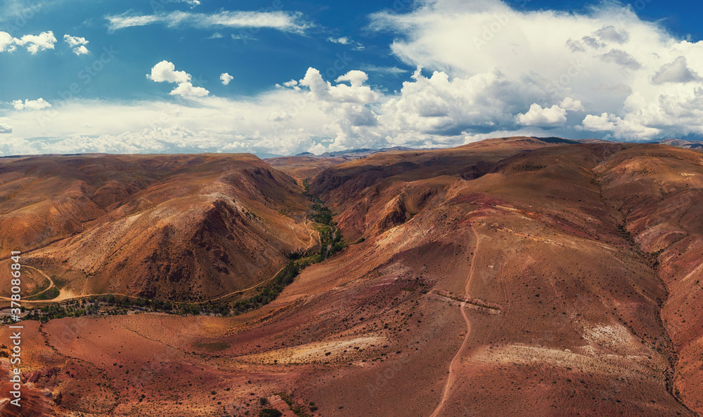 Fototapeta Aerial drone panorama of colorful eroded landform of Altai mountains with yellow, brown and red colors. Nature landscape in popular tourist location called Mars, near the border with Mongolia, Chagan