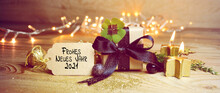 Frohe Neues Jahr 2021  Means Happy New Year 2021 - New Year Congratulations - Gift Box With Lucky Clover And Candles