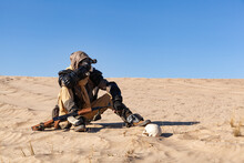 Post Apocalyptic Warrior Sitting In The Desert.