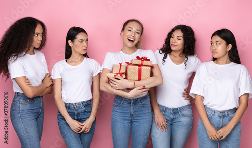 Envious Women Looking At Friend With Many Gifts, Pink Background Fototapeta