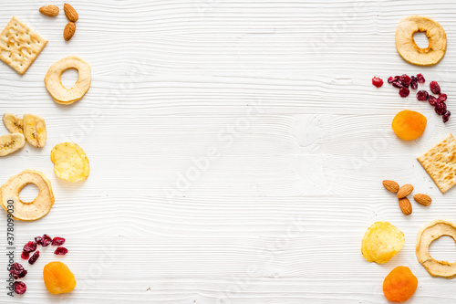 Flat lay of appetizers and snacks overhead. Nuts and dried fruits with crackers