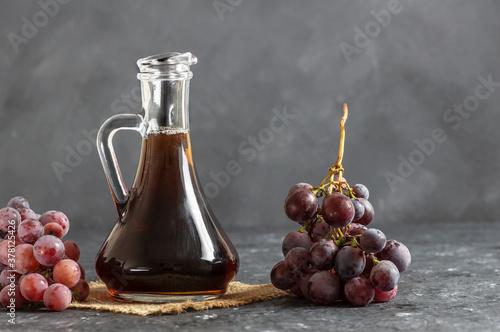 Glass bottle of organic black grape balsamic vinegar made from fermented fresh grapes Canvas-taulu