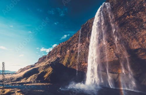 Seljalandsfoss waterfall at sunset, Iceland - 378125649