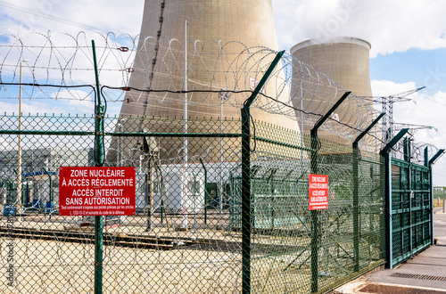 Security fence of a nuclear power plant in France with barbed wire and warning signs reading Nuclear area with restricted access Canvas