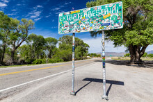 Crystal Springs, Nevada / USA - April 18 2017: One End Of The Extraterrestrial Hwy The Road Sign For Route 375 Covered In Stickers By Tourists Who Have Made The Journey Hoping To See The Unexplained.