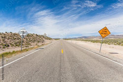 Driving along the 375 - Extraterrestrial Highway there are warning signs alerting drivers to the possibility of low flying aircraft, these would be out of the Groom Lake Military base Wallpaper Mural