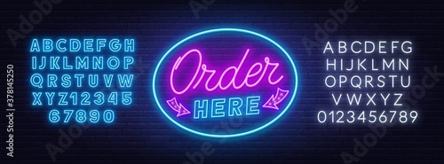 Order here neon sign on brick wall background Fototapet