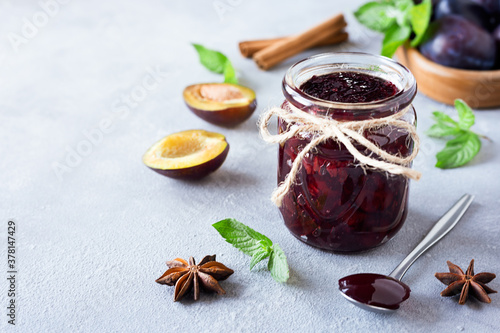 Plum jam and ingredients for its preparation: plums, cinnamon, star anise and mint Wallpaper Mural