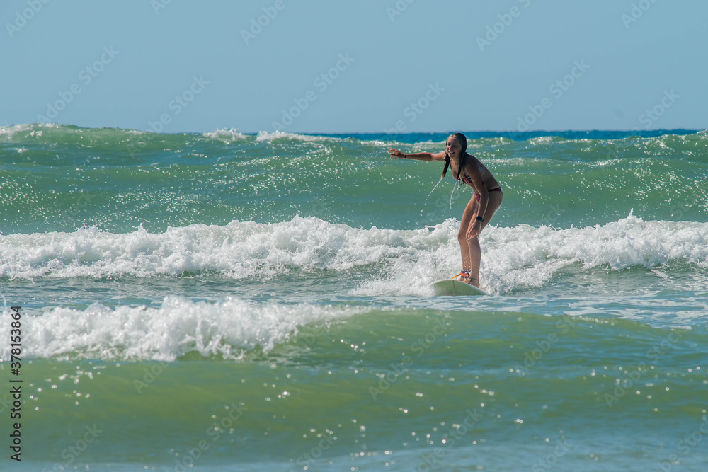 Fototapeta pretty surfer by the ocean