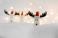 Three Christmas Deer In Red Ca...