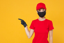 Delivery Employee Woman In Red Cap Blank T-shirt Uniform Protect Face Mask Gloves Working Courier In Service During Quarantine Coronavirus Covid-19 Virus Isolated On Yellow Background Studio Portrait.