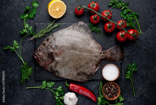 Fotografia, Obraz raw flounder with spices on a stone background
