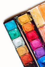 Watercolor Palette With Bright Colors On A White Background Shot From Above