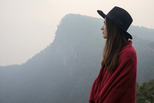 Young Woman In Black Hat And Red Poncho Outdoor Portrait