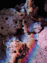 Porous Stones With Rainbow Light